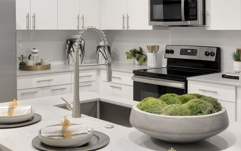 sink and dining island in bright kitchen